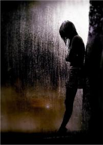Girl standing in rain