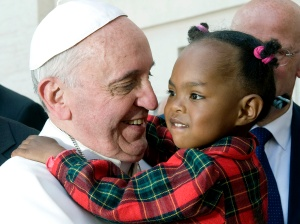 Pope Francis greets a child after celebrating Mass on the feast of Pentecost in St. Peter's Square at the Vatican May 19. (CNS photo/Alessia Giuliani, Catholic Press Photo) (May 20, 2013) See POPE-PENTECOST May 20, 2013.