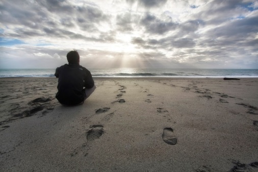 MAN-GAZING-INTO-UNKNOWN-BEACH-SUNSET