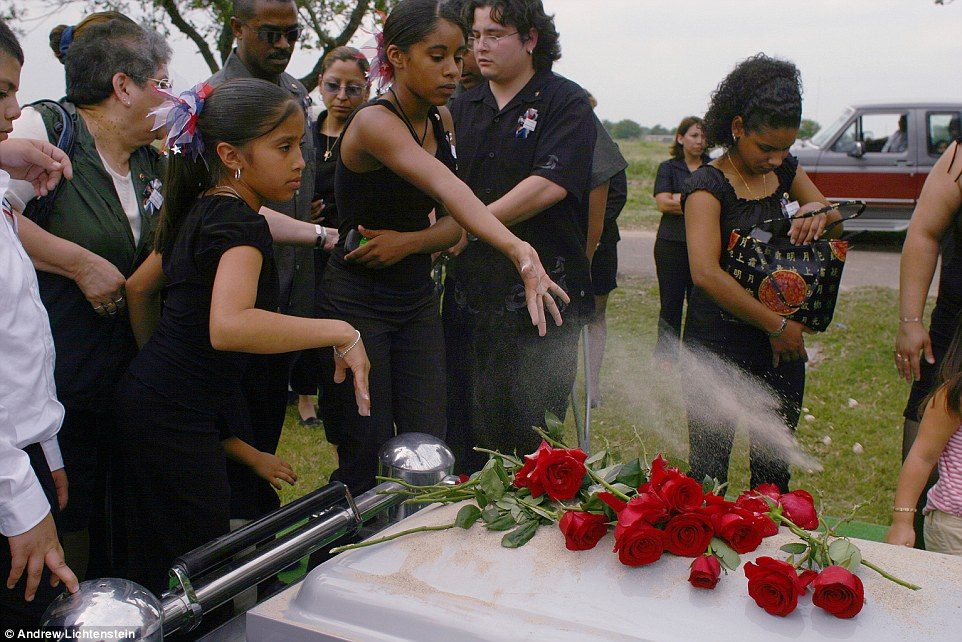 2903DA0700000578-3094457-Grieving_Here_family_and_friends_of_Army_Sgt_Christopher_Ramirez-a-64_1432415058137